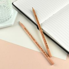 Personalised engraved wooden save the date pencils.